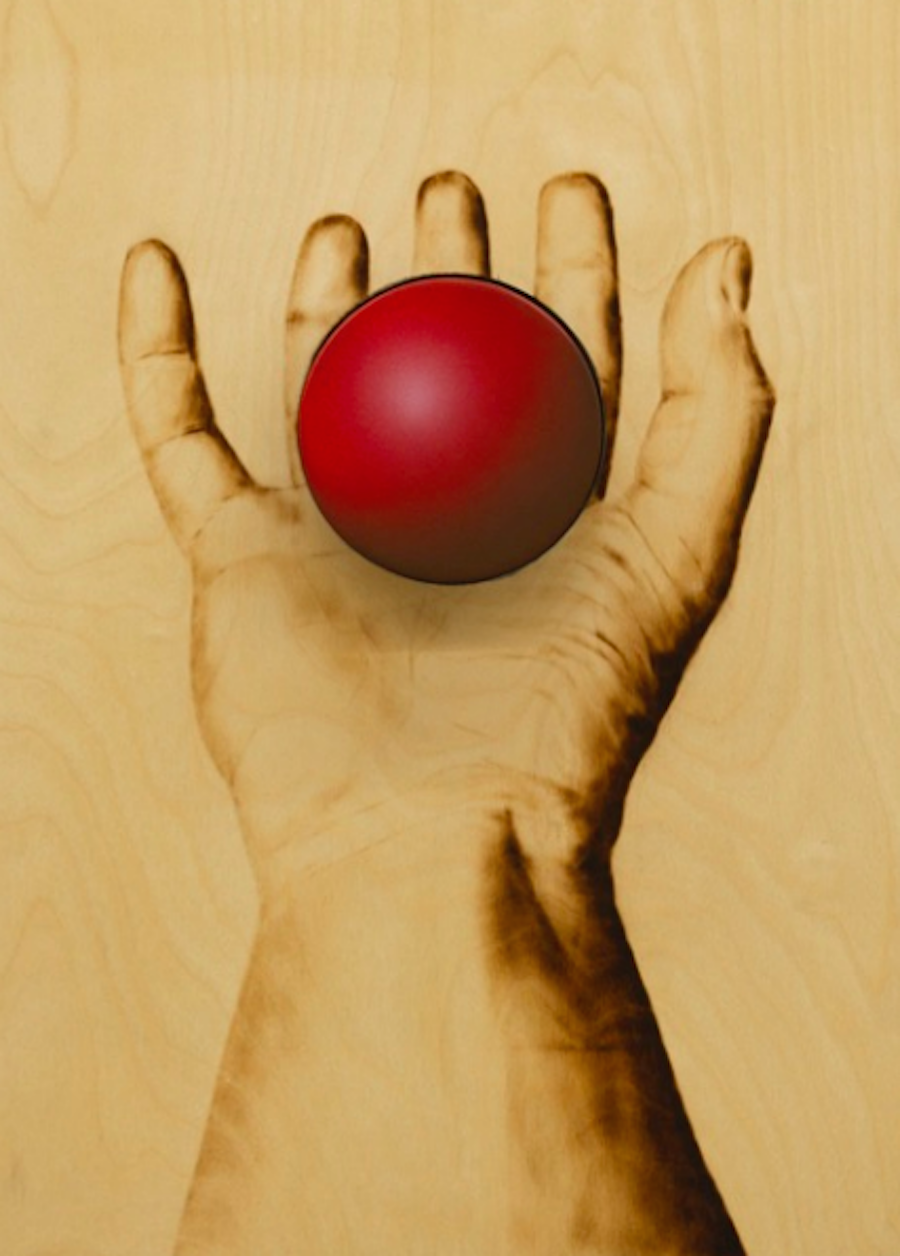 Red Ball on Hand by Ryan McCann