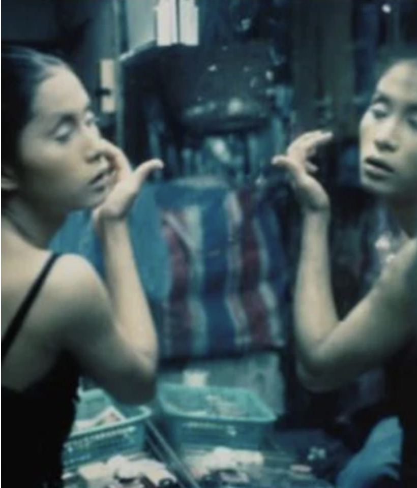 C putting on her makeup, Bangkok, 1992 by Nan Goldin